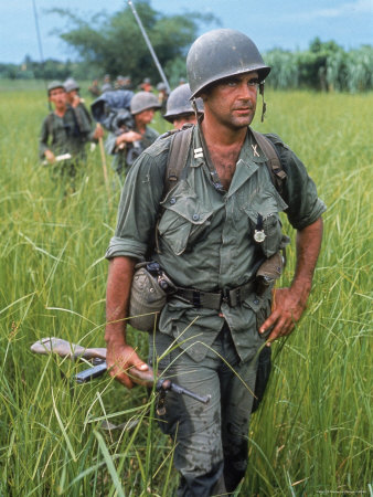553909~US-Army-Captain-Robert-Bacon-Leading-a-Patrol-During-the-Early-Years-of-the-Vietnam-War-Posters
